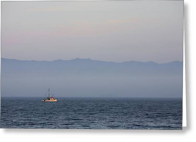 A Fishing Boat Sails Along At Sunset Greeting Card by Taylor S. Kennedy