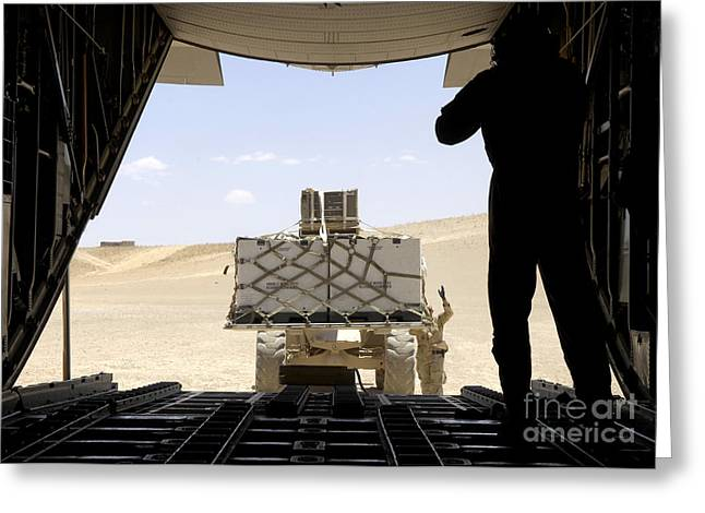 A Forklift Loads Cargo Onto A C-130 Greeting Card