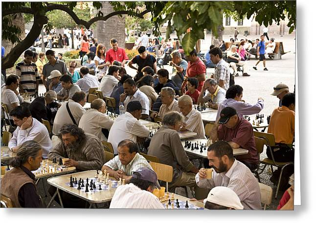 A Group Of Men Playing Chess In Plaza Greeting Card by Richard Nowitz