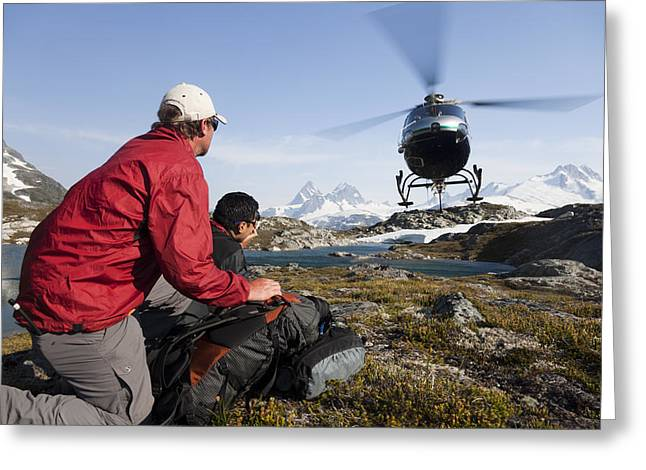 A Helicopter Picks Up Two Men Greeting Card