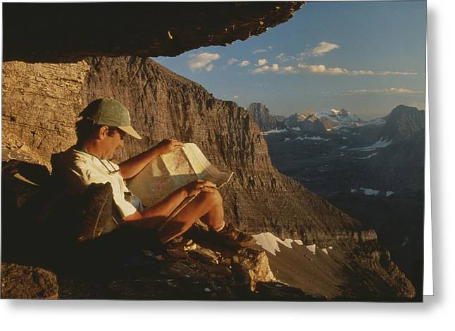 A Hiker Pauses To Rest And Read A Map Greeting Card