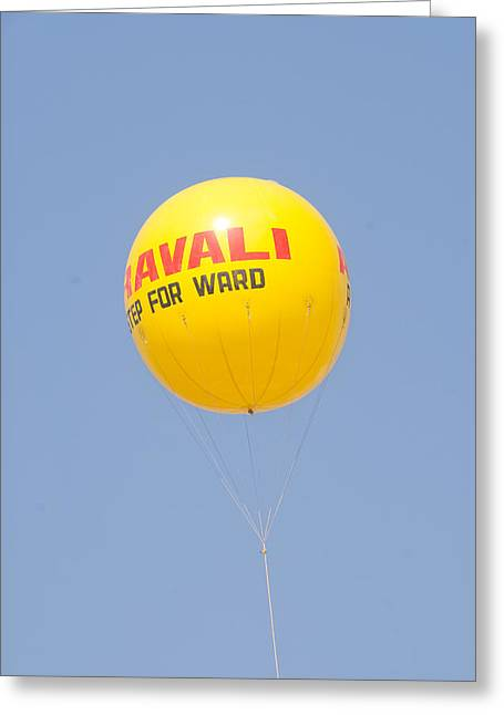 Greeting Card featuring the photograph A Hot Air Balloon In The Blue Sky by Ashish Agarwal