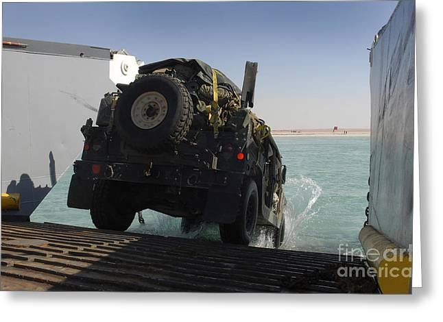 A Humvee Drives Down The Ramp Greeting Card by Stocktrek Images