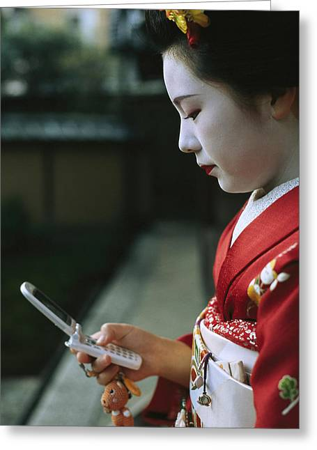 A Kimono-clad Geisha Dials Her Cell Greeting Card by Justin Guariglia
