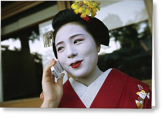 A Kimono-clad Geisha Talks On A Cell Greeting Card by Justin Guariglia
