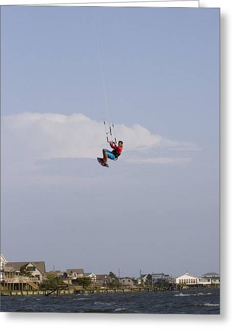 A Kiteboarder Jumps High Over Beach Greeting Card