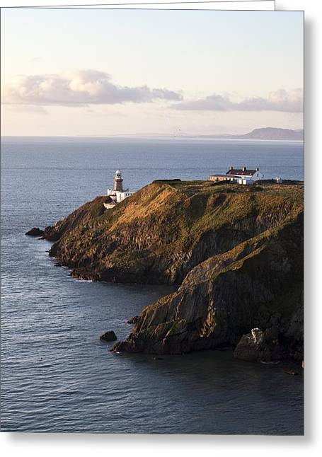 A Lighthouse On A Hill Ireland Greeting Card by Peter McCabe