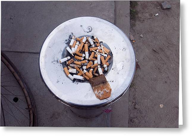 A Lot Of Cigarettes Stubbed Out At A Garbage Bin Greeting Card by Ashish Agarwal