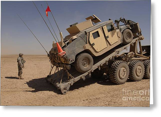 A M1114 Armored Vehicle Is Unloaded Greeting Card by Stocktrek Images