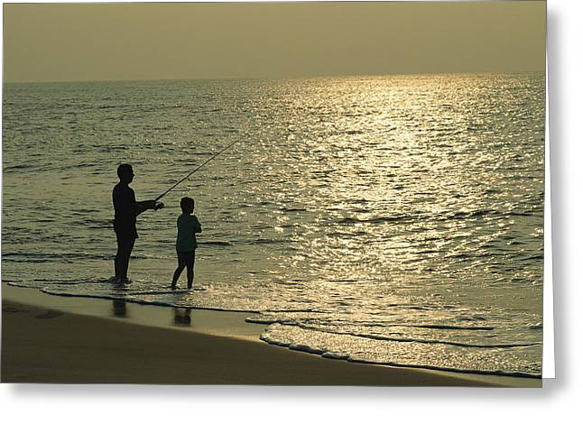 A Man And A Young Boy Fish In The Surf Greeting Card