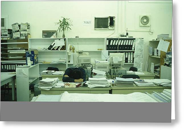 A Man Sleeps At A Desk Greeting Card