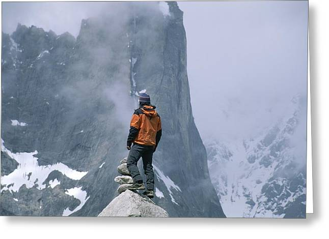 A Man Stands On A Cliff Watching Greeting Card by Jimmy Chin