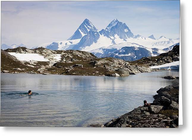 A Man Swims In A High Alpine Lake Greeting Card