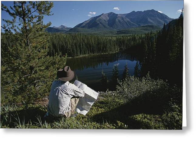 A Man With A Cowboy Hat Reads A Map Greeting Card
