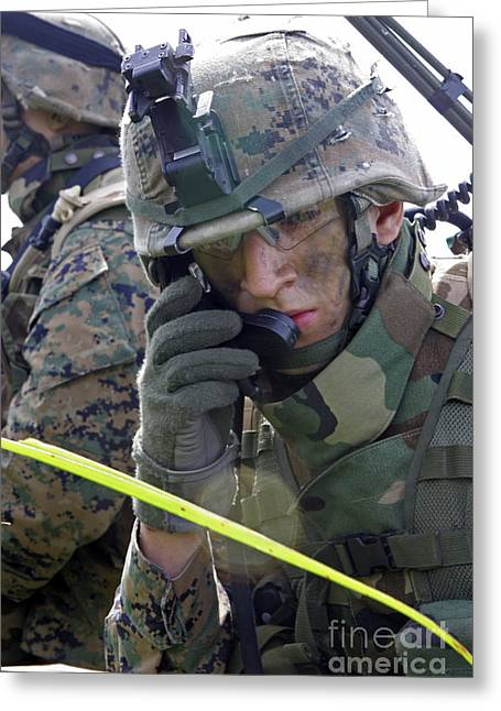 A Marine Communicates Over The Radio Greeting Card by Stocktrek Images