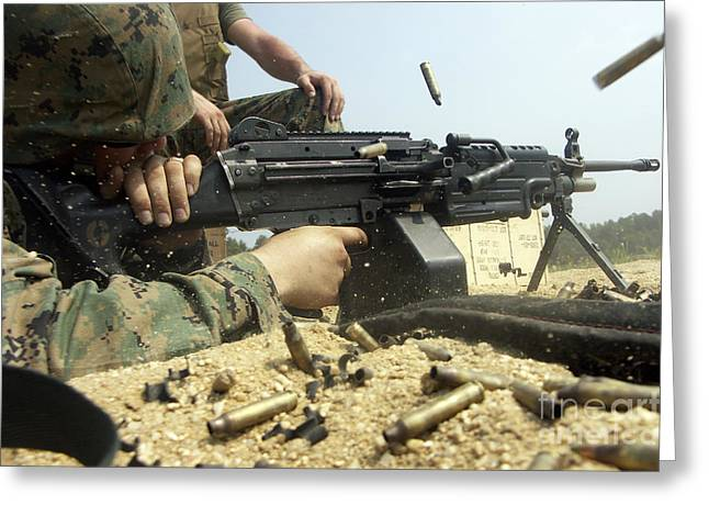 A Marine Engages Targets With An M-249 Greeting Card