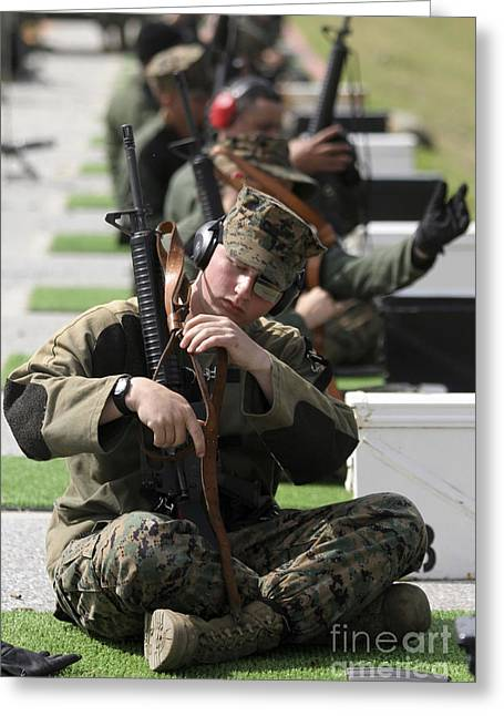 A Marine Makes Final Adjustments Greeting Card by Stocktrek Images