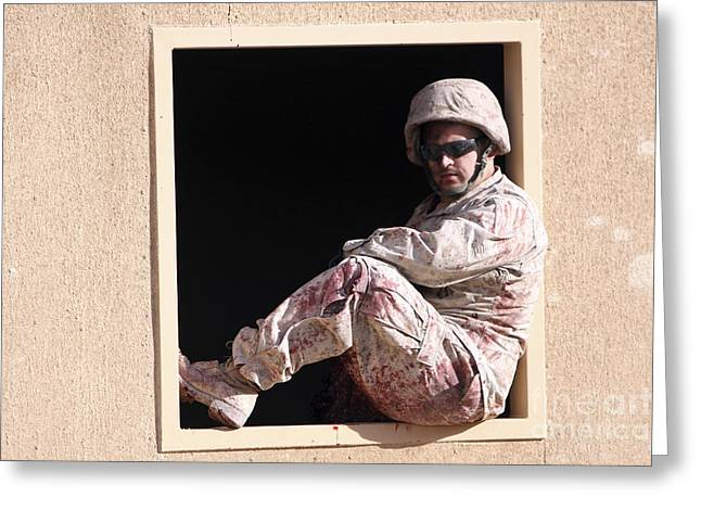 A Marine Role Player Sits In A Window Greeting Card by Stocktrek Images