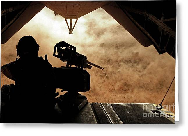 A Marine Waits For Dust To Clear While Greeting Card by Stocktrek Images