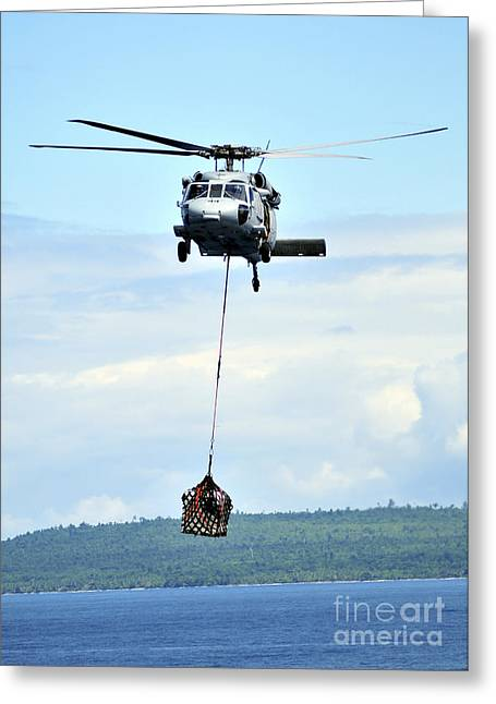 A Mh-60 Knighthawk Carries Supplies Greeting Card by Stocktrek Images