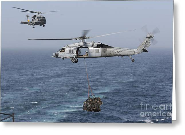 A Mh-60s Knighthawk Transfers Cargo Greeting Card by Gert Kromhout