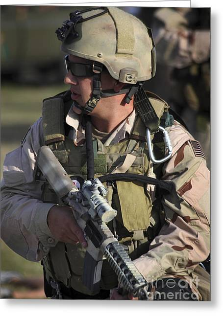 A Military Reserve Navy Seal Kneels Greeting Card by Michael Wood