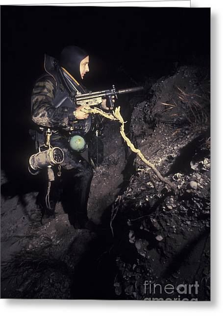 A Navy Seal Crosses The Beach At Night Greeting Card