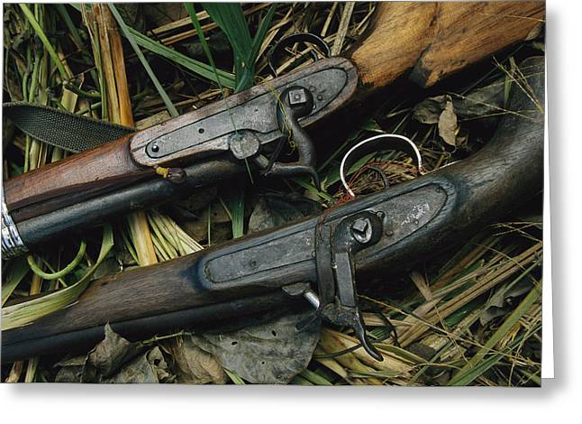 A Pair Of Old Flint-type Rifles Lying Greeting Card by Steve Winter
