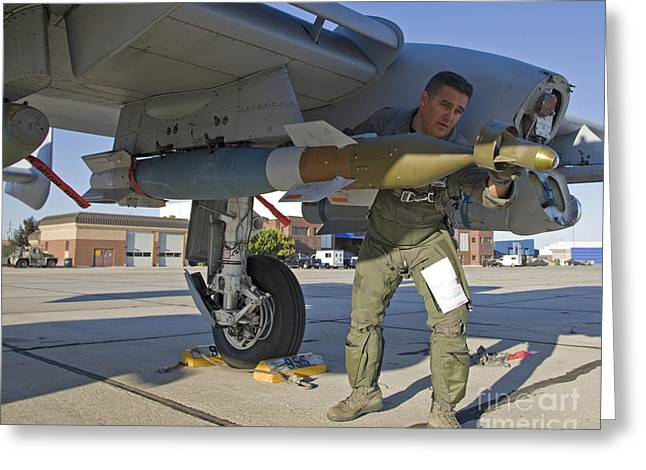 A Pilot Inspects A Gbu-12 Laser Guided Greeting Card