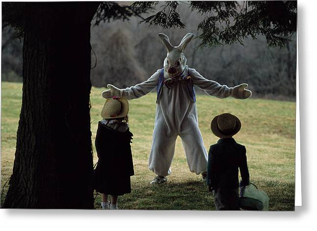 A Rabbit Meets Two Children During An Greeting Card by Joel Sartore