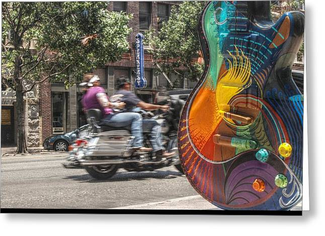 A Rainbow Guitar On Congress In Austin Greeting Card by Jennifer Holcombe