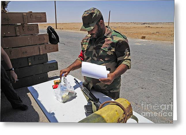 A Rebel Collects His Food Ration Greeting Card by Andrew Chittock