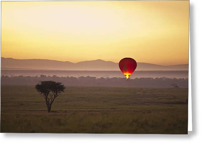 A Red Hot Air Balloon Takes Flight Greeting Card by David DuChemin