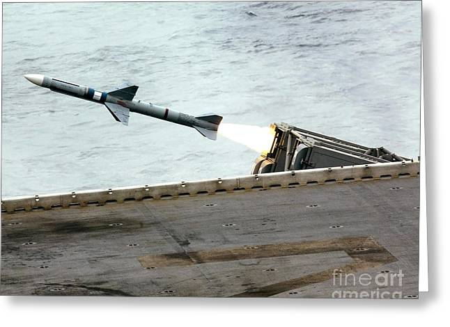 A Rim-7m Sea Sparrow Missile Is Fired Greeting Card by Stocktrek Images