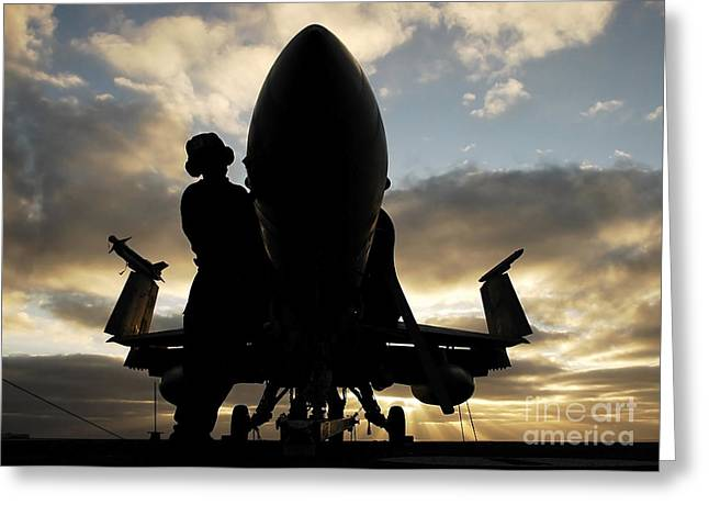 A Sailor Cleans The Nose Of An Fa-18f Greeting Card by Stocktrek Images