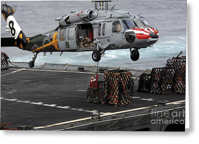 A Sailor Hooks Cargo To An Mh-60s Sea Greeting Card