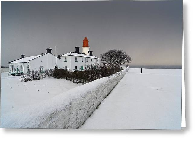 A Snow Covered Fence With A Lighthouse Greeting Card by John Short