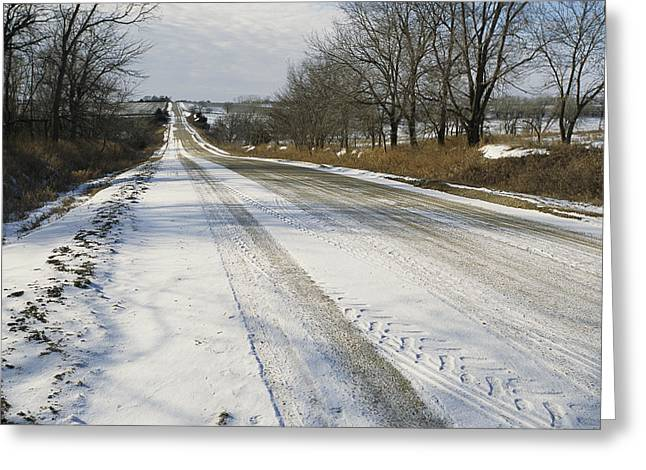 A Snow-covered Road Passes Greeting Card by Joel Sartore