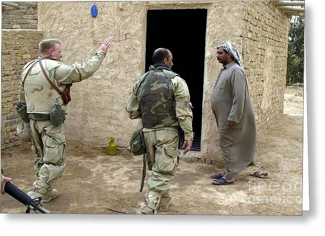 A Soldier Greets A Homeowner In Central Greeting Card