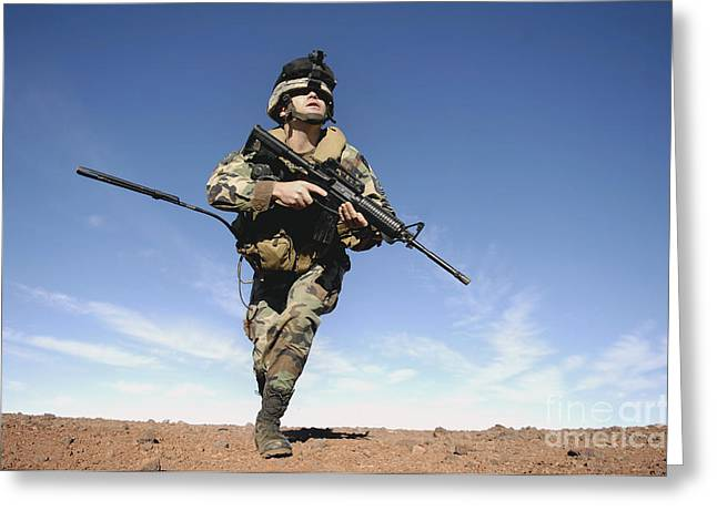 A Soldier Moves To Another Firing Greeting Card by Stocktrek Images
