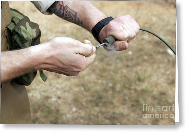 A Soldier Pulls A Detonation Cord Greeting Card by Stocktrek Images