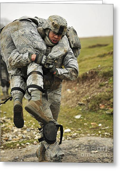A Soldier Transports A Fellow Wounded Greeting Card by Stocktrek Images