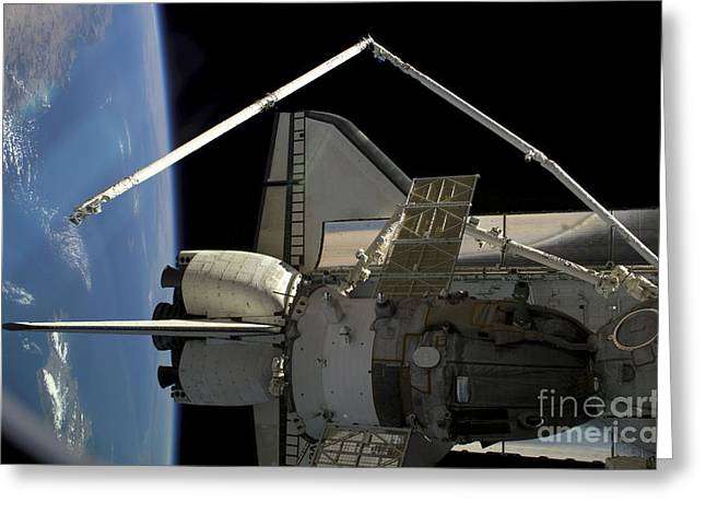 A Soyuz Vehicle And The Space Shuttle Greeting Card by Stocktrek Images