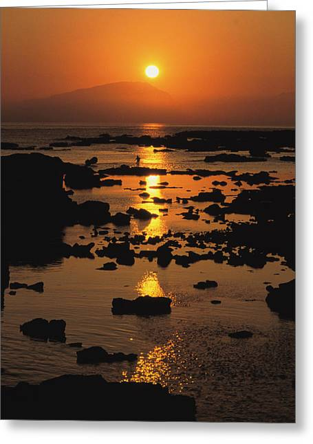 A Sunset On A River With Mountains Greeting Card