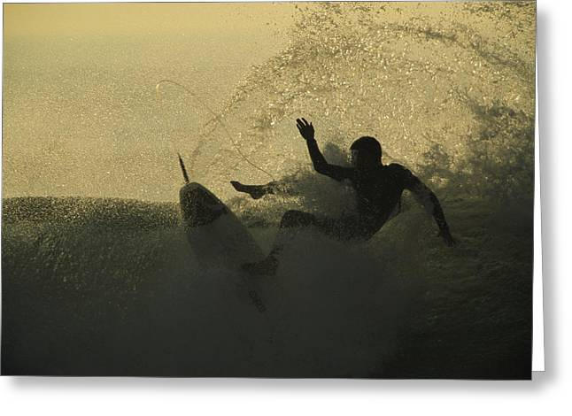 A Surfer Wipes Out On A Breaking Wave Greeting Card by Tim Laman