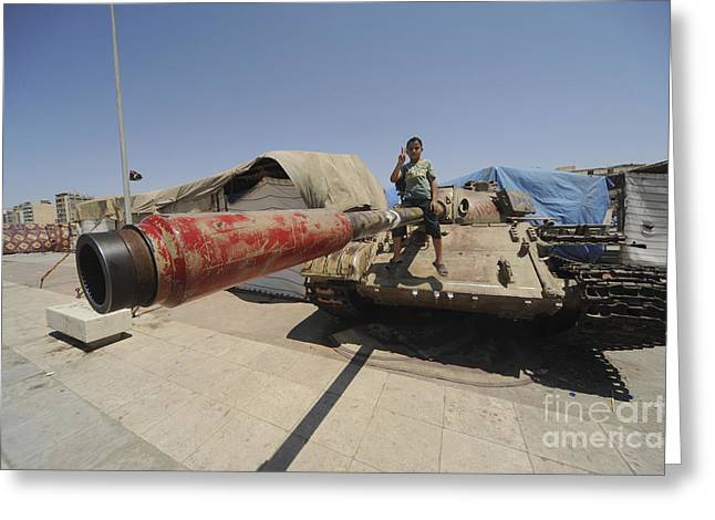 A T-55 Tank With Two Children Playing Greeting Card by Andrew Chittock
