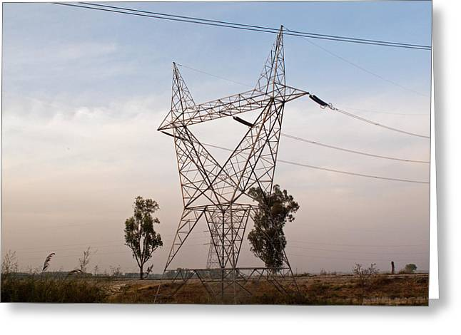 A Transmission Tower Carrying Electric Lines In The Countryside Greeting Card by Ashish Agarwal