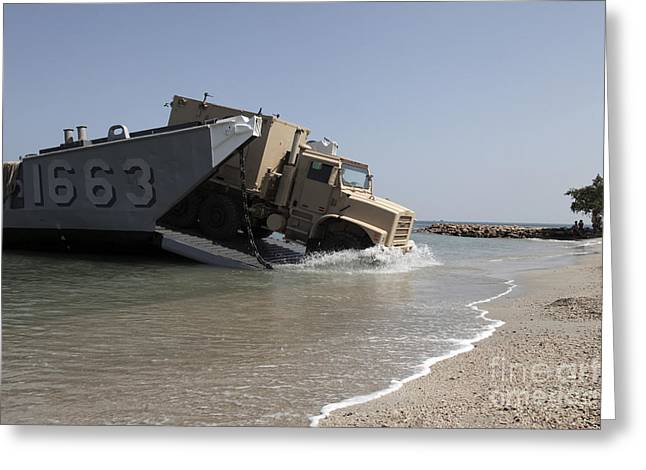 A Truck Offloads From A Landing Craft Greeting Card by Stocktrek Images