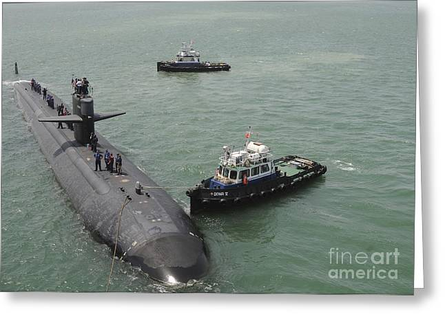 A Tugboat Guides Attack Submarine Uss Greeting Card by Stocktrek Images