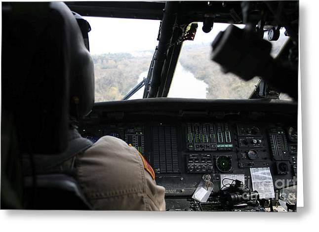 A Uh-60 Blackhawk Flies The River To An Greeting Card by Terry Moore